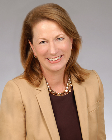Kathy McDonald, Assurant's President Global Specialty looking at the camera